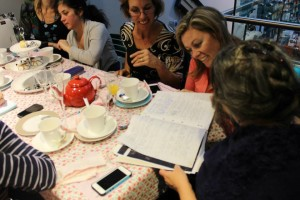 Guests at the High Tea examine my notebook