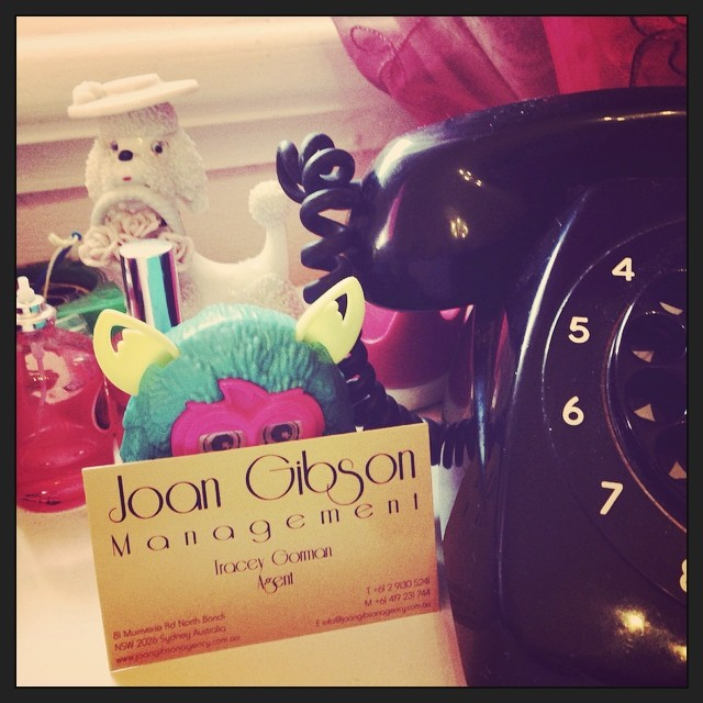 An agent's card guarded by. Furby. #joangibsontalentagency #daisy #family #love