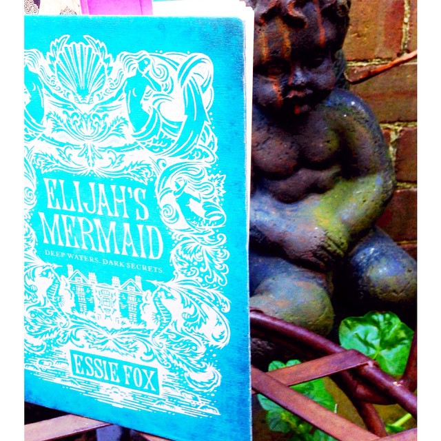 A perfect sunny day in the garden to finish reading the enchanting and clever Elijah's Mermaid by Essie Fox. One of those delicious books that remove you from the world around you as  you enter a darkly beautiful dream. #essiefox #elijahsmermaid #victorianart #mermaid #gothic #bookworm