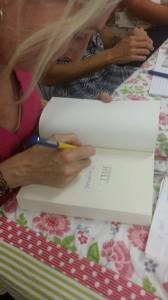 ANNA SIGNING BOOKS