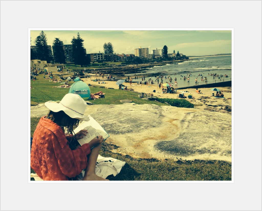 Daisy writing at Cronulla